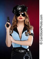 hermoso, posición, mujer policía, coloreado, policewoman., joven, aislado, arma de fuego, mientras, plano de fondo, tenencia, sexy, uniforme