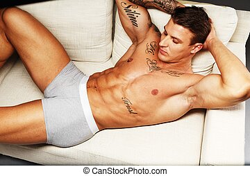 hermoso, ropa interior, sofá, muscular, acostado, torso, tattooed, hombre