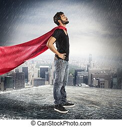 Hero confident boy - Guy on a roof dressed as superhero