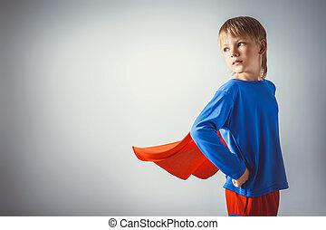 Little boy in suit a superman