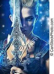 hero sword - Beautiful bellicose Amazon with a sword in...