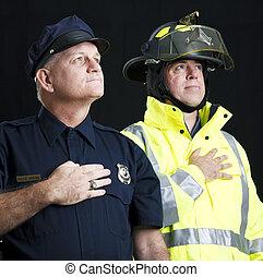 Heroic First Responders - Policeman and fireman saying the...
