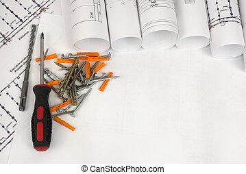 herramientas, rollosde papel, dibujos arquitectónicos