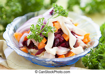 herring in a salad with beets and carrots