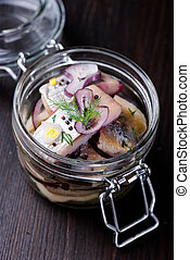 Herring marinated in oil with herbs