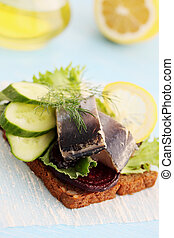 herring on a piece of bread