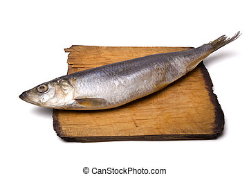 Herring on old wooden board