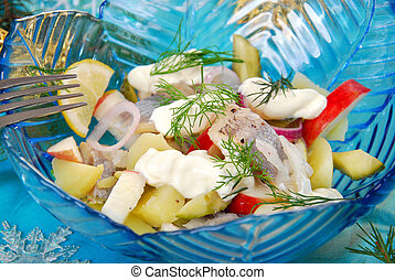 herring salad with apple , potato and sour cream