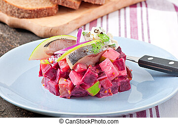 Herring salad with sour cream sauce