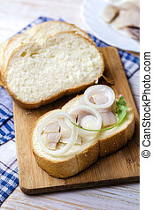 Herring with white onion on a piece of bread