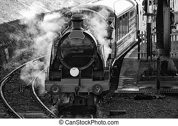 Hertifage old vintage steam railway engine in station with...