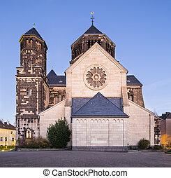 Herz-Jesu Church in Aachen, Germany at night - Side view of...