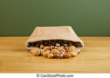 Hessian sack with mixed nuts spilling out