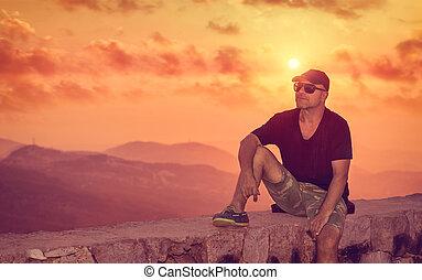 het genieten van, ondergaande zon , man