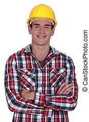 het glimlachen, de arbeider van de bouw