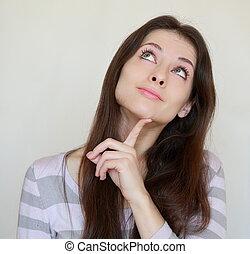 het glimlachen, denkende vrouw, kijkend, met, vinger, op, gezicht, isolated., closeup, verticaal