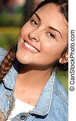 het glimlachen, jong meisje