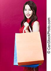 het glimlachen, jonge, aziatische vrouw, vasthouden, de, het winkelen zakken