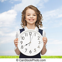 het glimlachen meisje, vasthouden, groot, klok