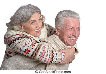 het glimlachen, paar, middelbare leeftijd