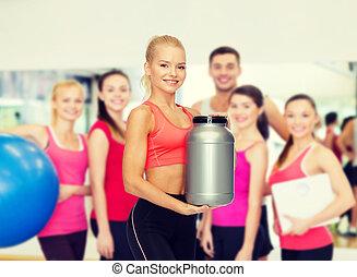 het glimlachen, sportief, vrouw, met, pot, van, proteïne