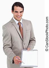 het glimlachen, vragen, verkoper, handtekening