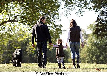 het lopen van de familie, hun, dog