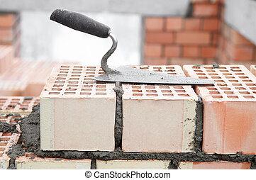 het materiaal van de bouw, voor, metselaar