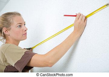 het meten, muur