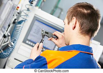 het meten van hulpmiddel, arbeider, detail