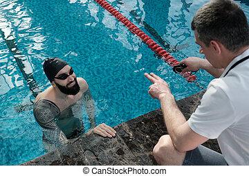 het roemen, trainer, zwemmer