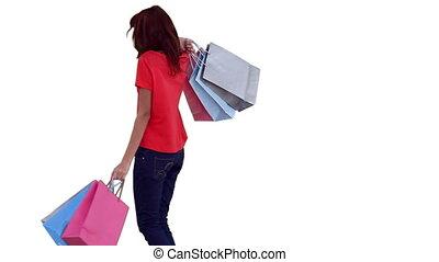 het spinnen, zakken, terwijl, shoppen , vasthouden, vrouw