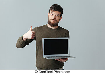 het tonen, duim, scherm, op, computer, leeg, draagbare computer, man