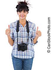 het tonen, duimen, fototoestel, vrouw, op