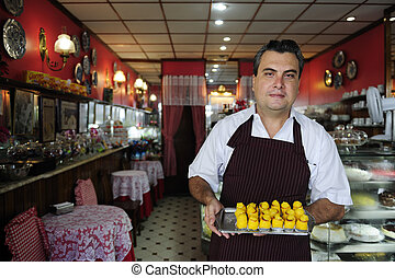 het tonen, kleine, smakelijk, gebakje, eigenaar, business:, koffiehuis
