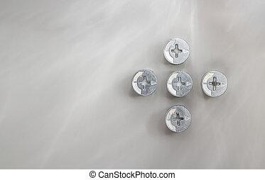 het verbinden, metalen, nootjes, grijze achtergrond, bout