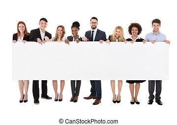 heureux, businesspeople, tenue, panneau affichage