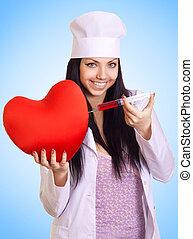 heureux, docteur féminin, injecter, a, seringue, dans, les, coeur rouge, sur, arrière-plan bleu