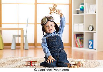 mignon jouet pilot gar on tre r ver avions enfant images rechercher photographies. Black Bedroom Furniture Sets. Home Design Ideas
