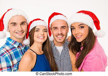 heureux, jeune, chapeaux, santa, amis, quatre, portrait