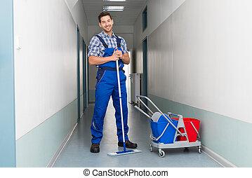 bureau balai ouvrier nettoyage couloir m le heureux images de stock rechercher des. Black Bedroom Furniture Sets. Home Design Ideas