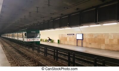 The iconic green and white HEV Suburban Railway Train leaving the undergound station in Budapest