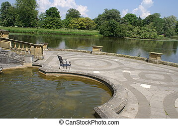 Hever castle patio, Kent, England - patio at a lakeside