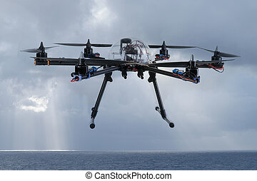 Hexacopter drone flying over the ocean - Close up view of a...