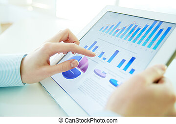 Hi-tech analysis - Close-up image of an office worker using ...