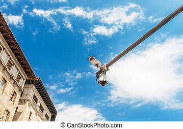 Hi-tech camera over the blue sky on street