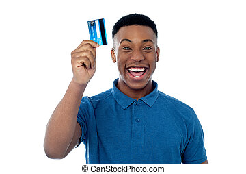 Hi! This is my new credit card! - Happy young man displaying...