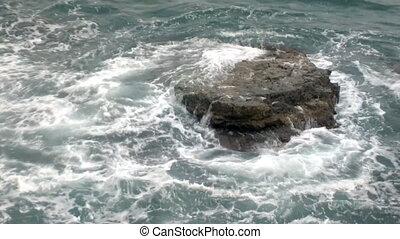 Hidden dangers. Stone reef in sea
