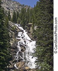 Hidden Falls in Grand Teton National Park, Wyoming tumbles down its rock face.