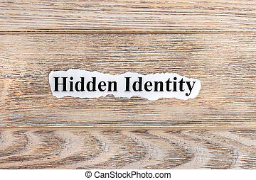 Hidden Identity text on paper. Word Hidden Identity on torn paper. Concept Image